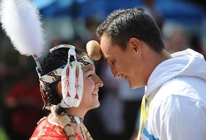 DENVER, CO. - SEPTEMBER 6: Sarah Ortegon (L), and Jean Carlton (R), participate in the Potato Dance competition during the 25th Annual Friendship Powwow at the Denver Art Museum in Denver, Colorado, Saturday, September 6, 2014. The event took place in Acoma Plaza outside the Museum Saturday afternoon, and included representatives from tribes around the country.  (Photo By Brenden Neville / Special to The Denver Post)